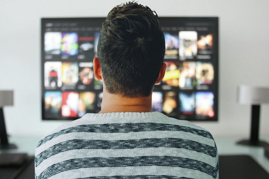 Man checking on streaming shows