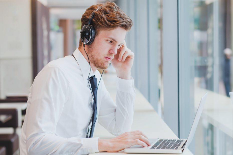 guy with headphones using laptop