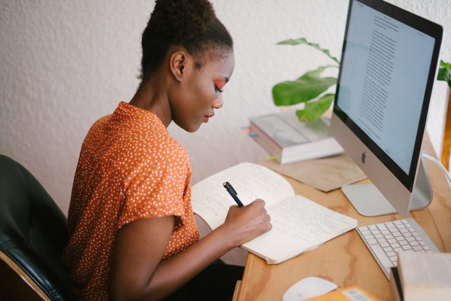 woman studying using transcripts