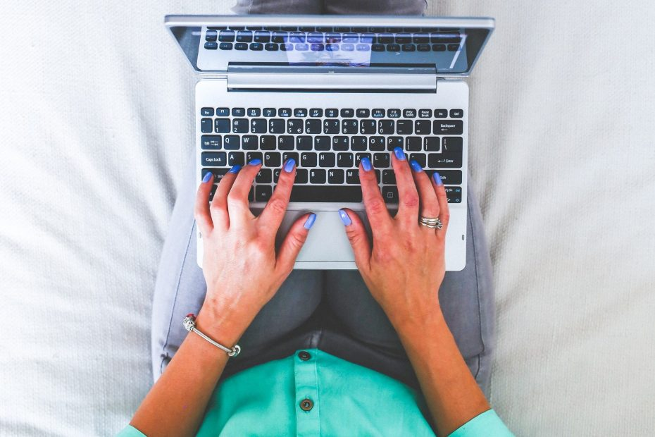 woman transcribing audio recording