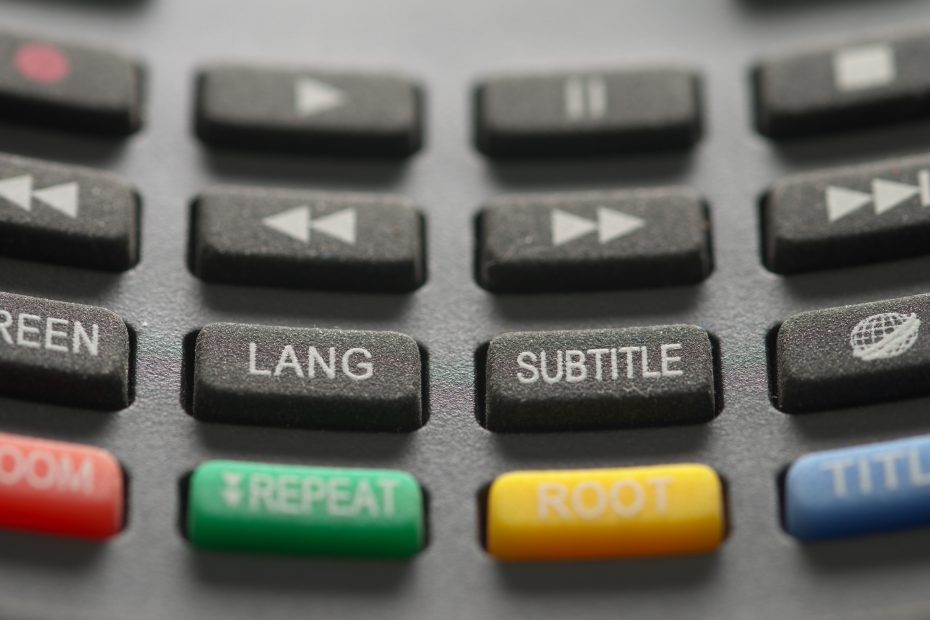 Remote with buttons labeled lang and subtitle